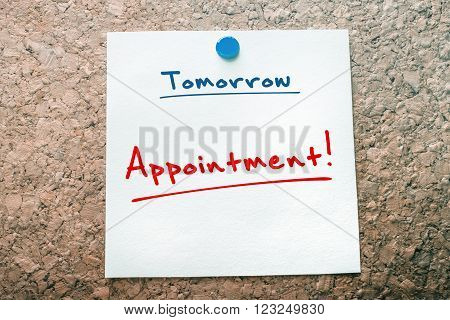 Appointment Reminder For Tomorrow On Paper Pinned On Cork Board
