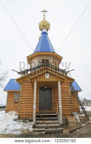 Irkutsk Region, Russia - March, 20 2016: Wooden church in Siberian village. Big Goloustnaya Irkutsk region