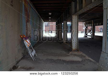 JOLIET, ILLINOIS / UNITED STATES - APRIL 12, 2015: Pedestrians may walk through the Van Buren Street Viaduct in downtown Joliet.
