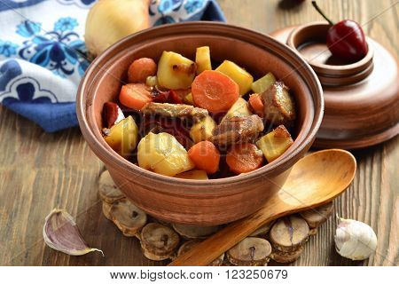 Beef stew with vegetables in a pot