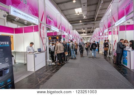 HANNOVER GERMANY - MARCH 15 2016: Multiple small China booths at CeBIT information technology trade show in Hannover Germany on March 15 2016.