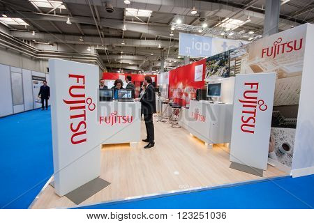 HANNOVER GERMANY - MARCH 14 2016: Booth of Fujitsu company at CeBIT information technology trade show in Hannover Germany on March 14 2016.