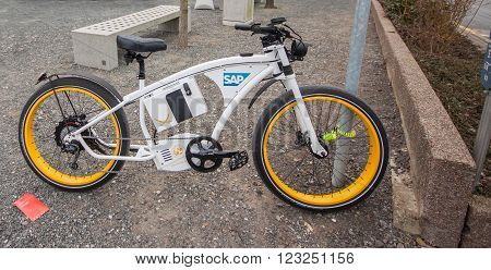 HANNOVER, GERMANY - MARCH 15, 2016: Electric bike Byke near SAP company booth at CeBIT information technology trade show in Hannover, Germany on March 15, 2016.