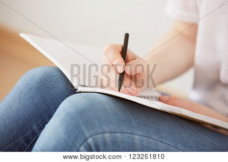 Close Up Lifestyle Image Of Pretty Young Teenage Girl Sitting On Her Floor And Making Notes To Her D