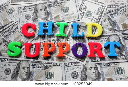 Child Support spelled in colorful letters on cash