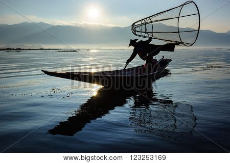 Silhouette fishermen in Inle Lake at sunrise Inle Shan State Myanmar
