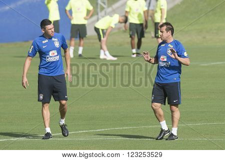 Teresopolis Brasil - March 22 2016: Coach Dunga conversation with former player Lucio during training of the Brazilian soccer team in Granja Comary