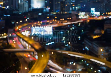 Night blurred bokeh city road intersection, abstract background