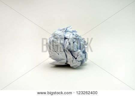 writer without inspiration crumpled paper ball on white