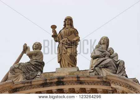 Catholic Sculptures on the Facade of a Saint-Michel-Archange Church in Menton French Riviera