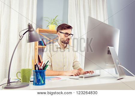 Handsome Man In Glasses Working With Pc And Typing In Office