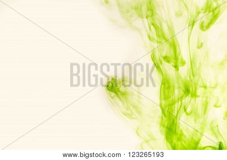 Green air dust soars over a light background