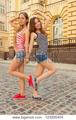 Two Pretty Girls Posing On The Street In Gumshoes And Shorts