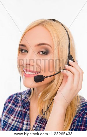 Close Up Portrait Of Smiling Agent Of Call Center Touching Microphone
