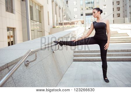 Portrait Of Cute Young Ballerina Standing At The Railing