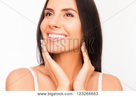 Young Attractive Young Woman Touching Her Face And Smiling