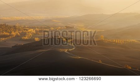 Italy, Val d'Orcia - Nov 06 : Wonderful sunset over the valley in on November 06, 2015 in Val d'Orcia, Italy
