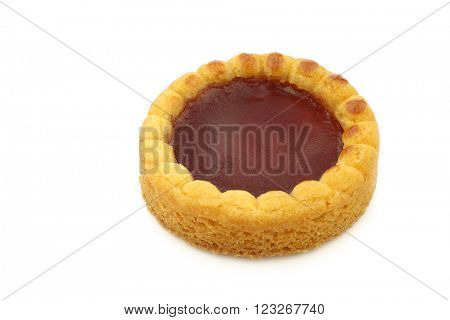 colorful round shaped and filled fruitcake on a white background