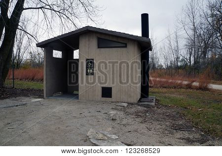 PLAINFIELD, ILLINOIS / UNITED STATES - OCTOBER 24, 2015: The Lake Renwick Heron Rookery Nature Preserve provides an outhouse where visitors may excrete waste.