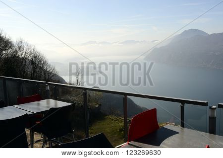 Large view of north Bourget lake and mountains from restaurant terrace of Chambotte, Savoy