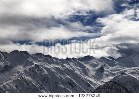 Ssnowy mountains and cloudy sky at evening. Caucasus Mountains. Svaneti region of Georgia.