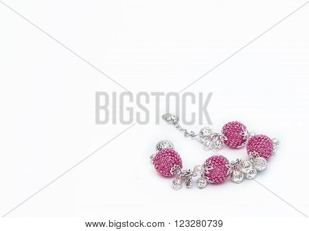 Pink beaded bracelet in the right corner