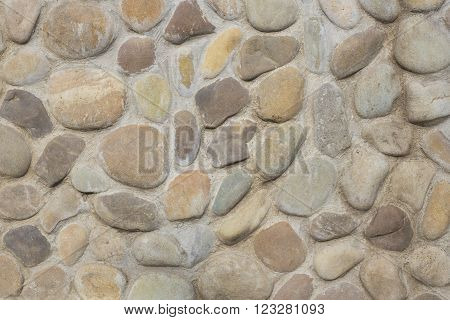 Pebble coating of a wall as a textured background