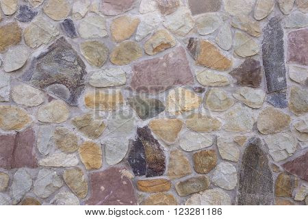 Stone cladding of a wall as a textuted backgound