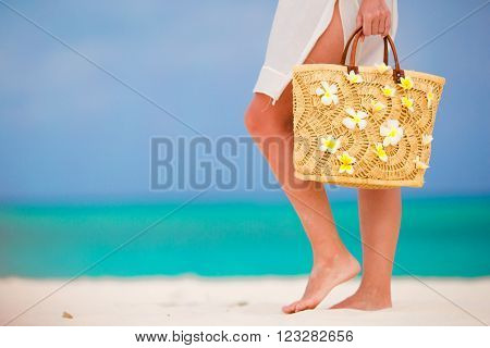 Close up of female feet on white sand beach