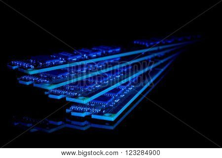 Electronic collection - computer random access memory (RAM) modules on the black background toned blue