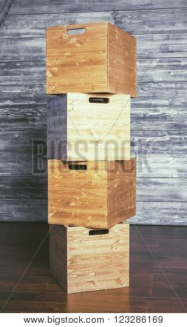 Stack of boxes on antique wooden background