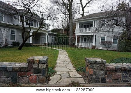 HARBOR SPRINGS, MICHIGAN / UNITED STATES - DECEMBER 23, 2015: A walkway leads to the front door of a large lakefront mansion on Glenn Drive in Harbor Springs.