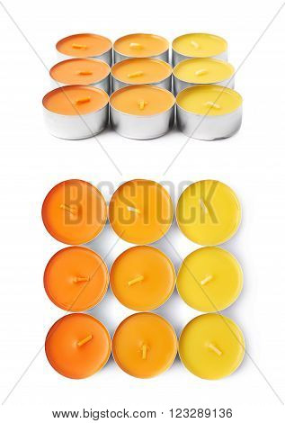 Multiple tealight paraffin wax orange candles composition isolated over the white background, set of two different foreshortenings