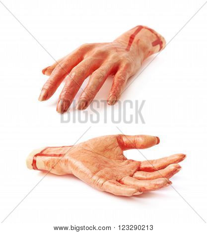 Fake rubber severed hand as a Halloween prank toy, isolated over the white background, set of two different foreshortenings