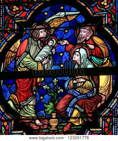 DINANT BELGIUM - OCTOBER 16 2011 Stained glass window depicting Joseph Mary Gabriel and Jesus in the Notre Dame church in Dinant Belgium