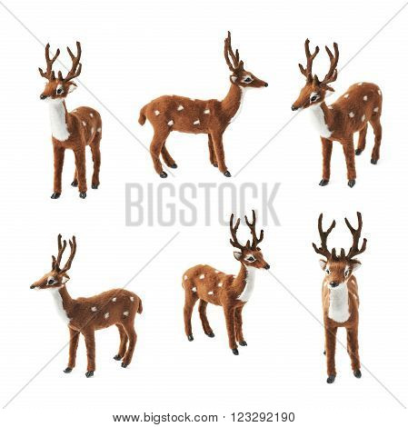 Toy roe deer fawn figurine isolated over the white background, set collection of six different foreshortenings