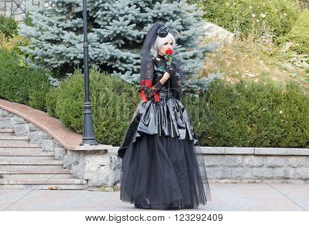 Kiev Ukraine - October 02 2015: Kiev Ukraine - Girl in gothic garb during a performance near Kiev Academic puppet theatre