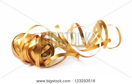 Glossy golden ribbon reel partly unwrapped, composition isolated over the white background