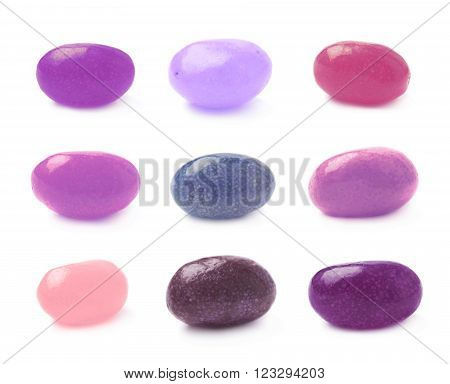 Single violet and purple jelly bean candy isolated over the white background, set of nine different foreshortenings