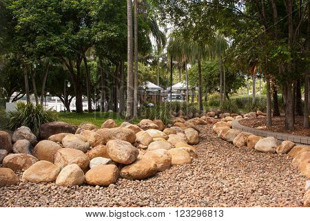 Brisbane, Australia February 14 2011: Tropical garden with rocks and stones for drainage at Southbank parkland.