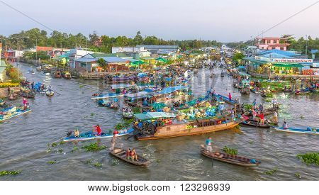 Soc Trang, Vietnam - February 3rd, 2016: scenes dawn dusk floating market trading of farm produce on the day Tet crowded with many boats out on the confluence of the countryside is beautiful in Soc Trang, Vietnam