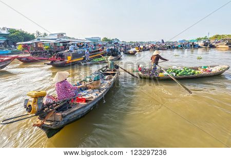 Can Tho, Vietnam - February 4th, 2016: Women rowing boats often algae farm trade in agricultural products on the market well as a livelihood in the countryside in the morning at the river in Can Tho, Vietnam.