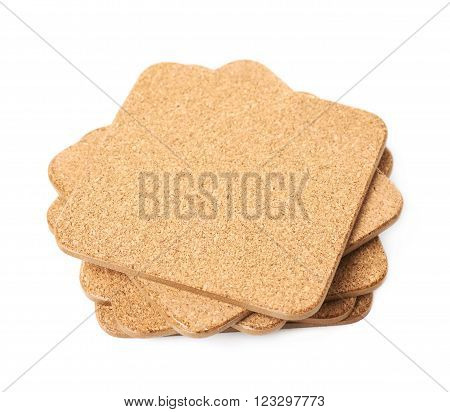 Pile of square cork textured drink's coasters isolated over the white background