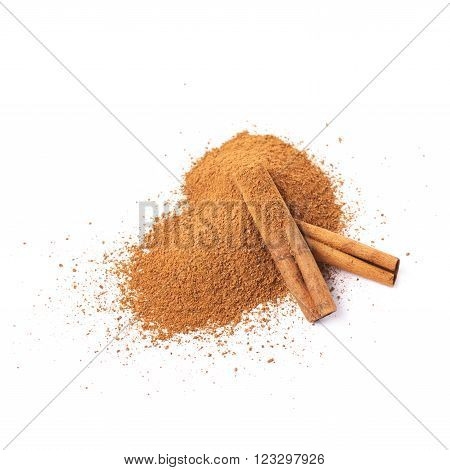 Pile of cinnamon powder with the raw bark sticks on top of it, composition isolated over the white background
