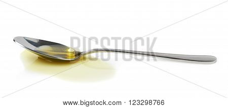 Steel spoon in a puddle of olive oil isolated over the white background