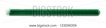 Glass test-tube filled with the green liquid, isolated over the white background
