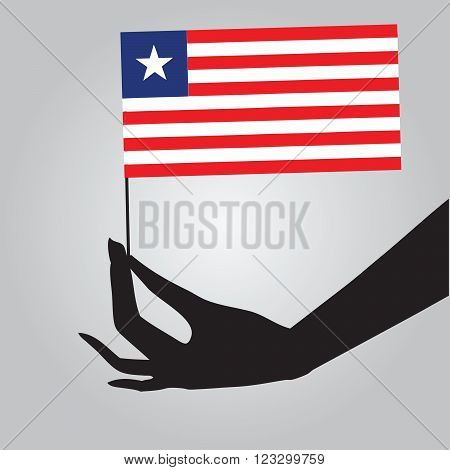 Flag of Liberia in a female hand. Vector illustration.