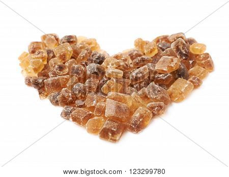 Heart shape made of large brown rock sugar crystals, composition isolated over the white background ** Note: Shallow depth of field