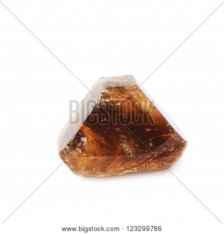 Single large brown rock sugar crystal isolated over the white background