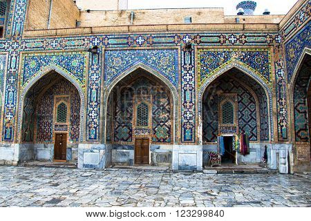 Detail of Madrasah Registan square and touristic shop Samarkand Uzbekistan